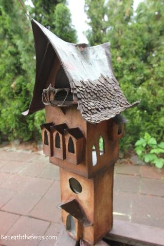 Fairy house miniature shake roof garden beneath the ferns