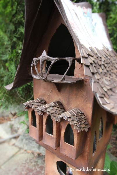 Fairy house miniature shake roof princess tower beneath the ferns