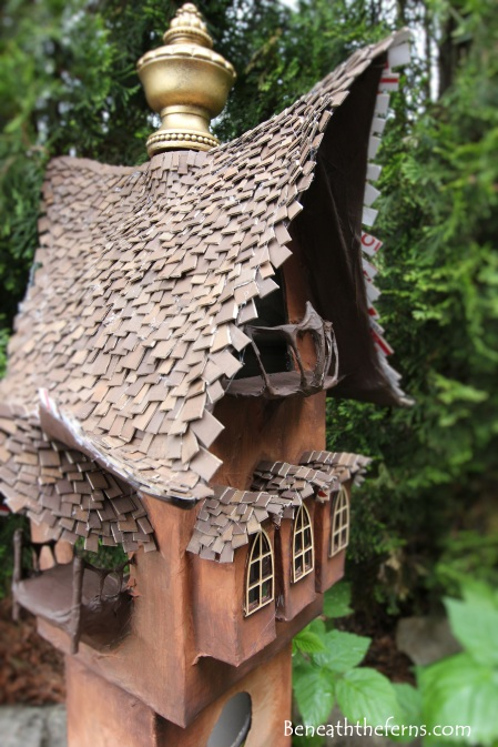 Fairy gardens house miniature scale tower by beneath the ferns close up